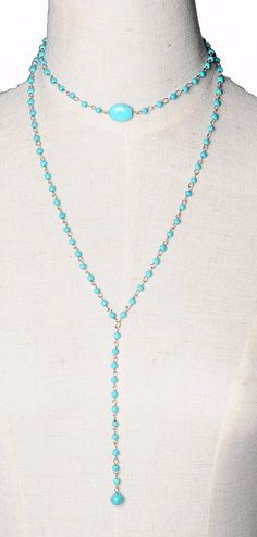 This is a very pretty semi-precious Black Stone Beads Necklace that has two lengths with a blue turquoise focal piece. This piece will go with many styles and outfits. - Silver Plated Zinc Alloy - 27.