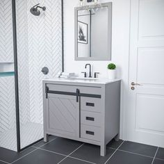 Rustic charm meets contemporary style with the Kinsley Vanity. The highlight of this piece is its sliding cabinet design with crosshatch motif, accented by antique-look hardware. Minimalistic in appearance, this austere yet handsome vanity lends quiet elegance to any guest or master bathroom space. It comes with a matching mirror for a coordinated designer look. Vanity Cabinet, Vanity Set, Single Bathroom Vanity, Master Bathroom, Marble Vanity Tops, Grey Cabinets, Cabinet Colors, Bath Vanities, Cabinet Design