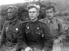 Soviet soldiers of the 127th Guards Artillery Regiment, 59th Guards Motor Rifle Division, pose for a photograph on the Don Front near the river Khopyor. The Don Front was a military formation of the Soviet Army that took part in the Battle of Stalingrad from its positions between the Volga and the Don rivers. 23-year-old Guard Captain Pavel Pankov (center) was awarded the Order of the Red Star for bravery in battle. Near Novokhopyorsk, Voronezh Oblast, Russia, Soviet Union. May 1943.
