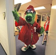 Phillie Phanatic gets ready for the game with Christine Powers, Friday, July 8, 2011. ( Steven M. Falk / Staff Photographer )
