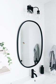 Our Master Bathroom Fixer Upper | Simply Well Spent - Black Modern Oval Mirror from Umbra - Matte Black Finishes and Fixtures #bathroomfixtures