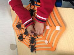 Halloween speech and language therapy reinforcer from dollar tree web and spiders. Add some Velcro and presto, the kids have been going crazy putting the spiders on during articulation or phonology drills. Also targeted top/bottom