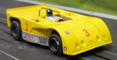 AFX Lola 260  with the rear deck filled in and a spoiler added.  Note the custom roll bar