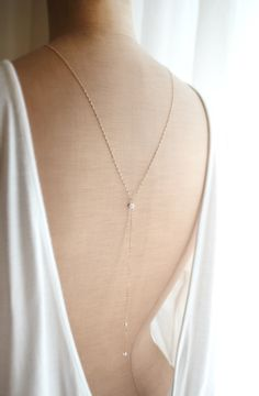 back necklace for brides or bridesmaids who look for a simple and elegant jewelry for their open back dresses