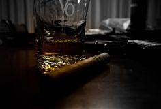Cigar, whiskey and gun.