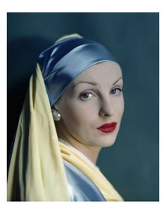 Published August 1, 1945    Photographer Erwin Blumenfeld shot this portrait for the August 1, 1945, Vogue, styling his model after Dutch painter Johannes Vermeer's 17th-century masterpiece known as Girl With a Pearl Earring. She wears a blue and yellow head wrap and blouse and a large pearl stud. Her bright red lips offset the dreamy gaze of her sky-blue eyes.
