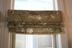 """After creating some """"dummy panels"""" for our breakfast nook, I had some fabric left over. I had planned on using the remnant for some throw pillows, but on an impulse, decided to make two faux roman shades instead! I think I've read every faux roman shade tutorial out there, but Richella's is by FAR my …"""