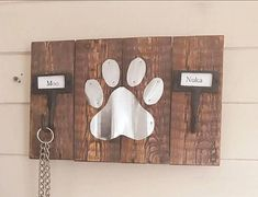 Pallet wood Dog leash / collar holder with corrugated roofing tin paw print Metal Dog Kennel, Wooden Dog Kennels, Diy Dog Kennel, Corrigated Metal, Portable Dog Kennels, Wood Dog Bed, Dog Leash Holder, Diy Pallet Projects, House Projects