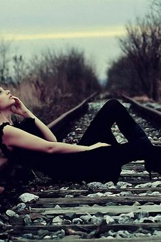 daydreaming on an abandoned train track.