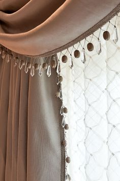 Beautiful satin drapes with swags and crystal breaded trimming © Hill House Interiors