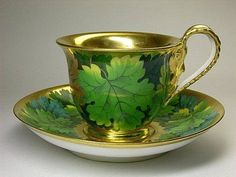 Tea cup and saucer, gorgeous green and gold.