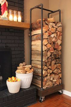 A simple support made of metal pipes and wood perfectly fits in the corner right next to the fireplace. Plenty of room for firewood. The castors make it easy to roll the unit wherever it's needed. | via homedit.com