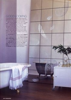 giant mirror was created with mirror tiles and then stenciled with feathers