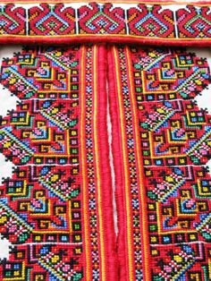 Close-up of embroidered collar and chest panels for a man's traditional Ukrainian 'sorochka', or shirt, in the style of Horodenka region villages of Yaseniv-Pil'nyi, Chernyatyn, Tyshkivtsi, Chortovets, and Kotykivka, from Carpathian Western Ukraine (Hand embroidered by Dave Melnychuk)