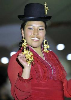 An indigenous Bolivian Aymara woman takes part in a fashion show in La Paz .