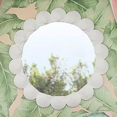 The Emily & Meritt Shell Mirror: Bring the beach to your bedroom and give your primping station a unique and decorative update. This sweetly styled mirror is surrounded by seashells and features a stunning antique finish. Easy to hang, it's an eye-catching accent for sparse or boring walls and is designed exclusively for PBteen by celebrity stylists and fashion designers Emily Current and Meritt Elliott.