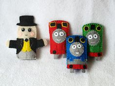 The full set of Thomas the Tank Engine felt finger puppets handmade by Joanne Rich for her friends daughter.