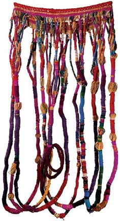Sheila Hicks is an American fiber artist who presents textile art as an experience situated between sculpture and performance
