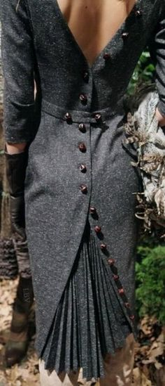 [I'm guessing on the decade.  This is a fantastic dress--wow.  But won't those buttons be uncomfortable to sit on?] Sidelocks And Foxhounds