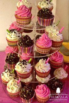 Tower of vanilla, strawberry and chocolate cherry cupcakes