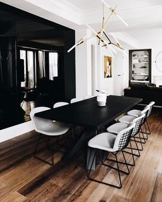 Bertoia chairs and black table