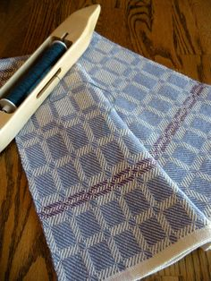 Kitchen towel designed and handwoven in Swedish Drall in periwinkle blue and white twill blocks in 100 percent cotlin. This type cotlin yarn