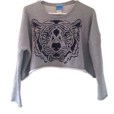 Hipster crop sweatshirt. Tiger shirt. Embroidered. ❤️All $9 tops - 2 for $15; 3 for $20❤️Super cool slouchy crop top. With embroidered tiger. Unfinished bottom hem and sleeves. Great pre-owned condition. Gray cropped top. Size medium, but I think it would fit a small as well.  It's short, but slouchy and oversized. ❤️if you're interested in the 2 for/3for deal, let me know and I will make a custom listing for you for a limited time👍 Tops Crop Tops