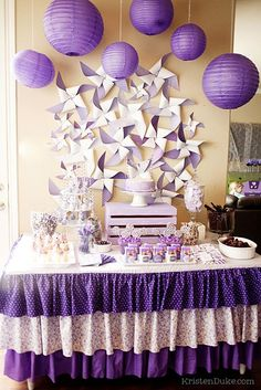 Great dessert table for a wedding, baby shower or birthday party. All different shades of purple. Plum, lilac, lavender. Pinwheels for the backdrop.