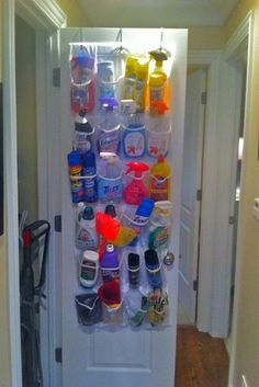 Keep your cleaning supplies in a shoe organizer that hangs over your door to maximize the space in your home. Source: Whine & Cheez