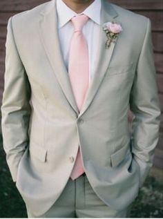 I like the look of the groomsmen wearing ties and the groom would wear a vest & a bow tie, so he stands out if they're wearing the same color tux.