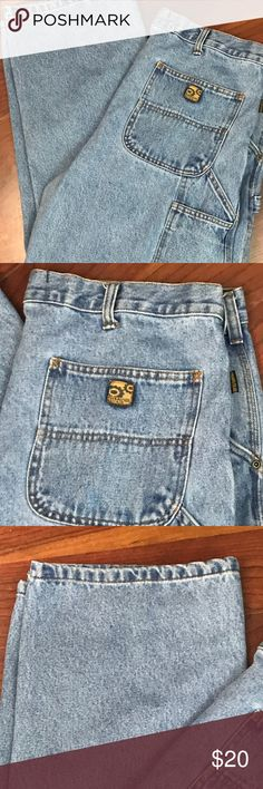 """Gravel Gear Men's 36 Carpenter Work Jeans Great pair of Gravel Gear Relaxed Fit carpenter style jeans.  Men's 36 x 29.  Light color denim.  Great pre-owned condition. No holes or frays.  There is one faint stain on bottom of right leg.  Please see pic.  Tag reads 36 x 30.  Actual inseam = 29""""  Waist measured flat across = """".  Inseam = 29"""".  Rise = 13""""  Hem opening flat across = 9"""".  Thanks for looking and please feel free to ask questions. Gravel Gear Jeans"""