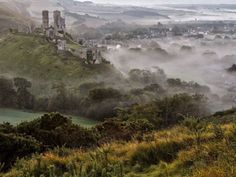 An early morning view of Corfe Castle and village in Dorset from the Purbeck hills | by Glyn Thomas/Rex Features