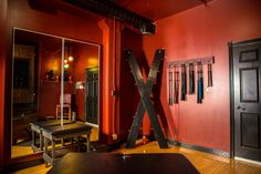 It is a bit softer and has a lower bondage bed, St. Andrew's Cross, floggers, paddles and lots of other toys are available in this room for rent. Dungeon Room, Red Rooms, Secret Rooms, Play Spaces, 50 Shades Of Grey, Bed And Breakfast, My Room, My House, House Plans