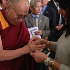 #inspirational Dalai Lama with Alex and Ani's designer Carolyngetting a positive bracelet from Alex and Ani