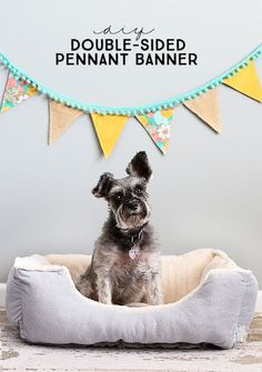 I love pennant banners!  This double-sided pennant banner tutorial is perfect and makes a great photography backdrop or fun addition to any space.  livelaughrowe.com #ad
