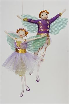 Halinka's Fairies-Sugar Plum Fairy and her Prince Designed and handmade by Halinka this popular pair are dressed in the colours of a sugared plum with a touch of green. They will sparkle with the fairy lights on your tree. They measure 12 to 13cm tall and have a hanging loop.