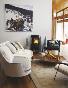 This chalet-style living room seriously works the modern rustic look. A roaring fire, softs furs and snuggly throws scream comfort, and it's worth knowing that you don't need to go too big on Christmas decorations when a space is this cosy. Something as simple as small artificial trees could serve you for several years… Image: Livingetc