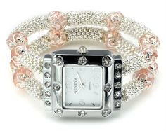 This vintage style watch resembles a family heirloom from the 1920's. This watch is accented with beautiful pink beads and dazzling clear round cut crystals. The watch measures 1 inch wide and is on a stretch comfort fit band. The face of the watch measures 3/4 of an inch wide and is encased in white metal and stainless steel. The watch is water resistant.