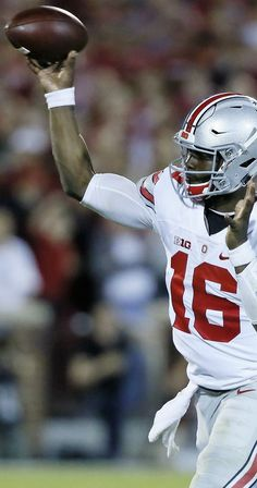 Ohio State Buckeyes quarterback J.T. Barrett (16) launches a touchdown pass to wide receiver Noah Brown (80)