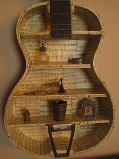 Music lovers will want this one-of-a-kind Guitar Shelf for their studio wall. Music lovers will want this one-of-a-kind Guitar Shelf for their studio wall. Lined with sheet music and varnish, this unique piece has Source b. Music Furniture, Diy Furniture, Upcycled Furniture, Casa Rock, Guitar Shelf, Guitar Crafts, Sheet Music Crafts, Guitar Room, Music Guitar