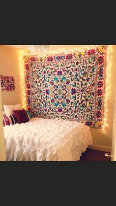 Hanging a tapestry is super smart for renting!! @Sarah Chintomby Chintomby Calvert  this reminds me of your room. it'd be cute if you put your lights around your tapestry