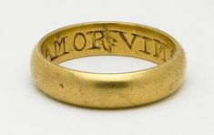 Gold posy ring  Inscription: AMOR VINSIT OMNIAE 'Love Conquers All'