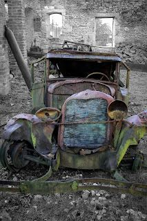Wrecked car at the abandoned village of Oradour-sur-Glane (France) Abandoned Cars, Abandoned Places, Abandoned Vehicles, Vintage Trucks, Old Trucks, Pompe A Essence, Rust Never Sleeps, Rust In Peace, Rusty Cars