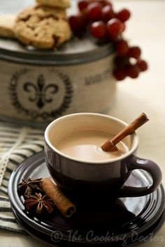 Indian Masala Chai   Serves 2    Prep 5 mins    Cook 10 mins  11⁄2 cup milk  1⁄2 cup water  1 tbsp loose tea leaves  1 tbsp sugar (optional)  1 inch freshly grated ginger   2 cardamom pods  1 cinnamon stick  1 clove   1. In a milk pan, boil the milk, water and tea leaves.  2. Add in all the spices and sugar.  3. Strain the tea once boiled, and discard all the spices.  3 Serve warm.