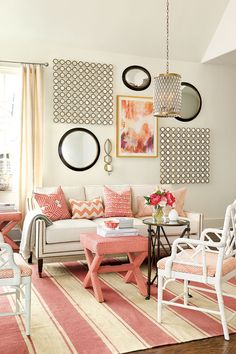 Living room with coral color palette via How To Decorate.