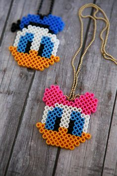 The best DIY projects & DIY ideas and tutorials: sewing, paper craft, DIY. Best Diy Crafts Ideas For Your Home Daisy and Donald Perler Bead Necklaces. Fun activity for the kids! Hama Beads Design, Diy Perler Beads, Hama Beads Patterns, Perler Bead Art, Pearler Beads, Fuse Beads, Beading Patterns, Embroidery Patterns, Bracelet Patterns