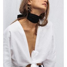 Neck scarf, front-tie white blouse, and statement gold earrings