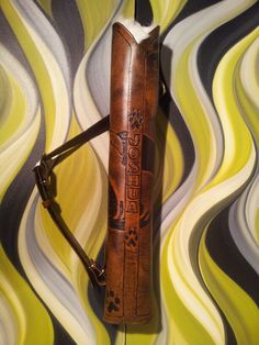 Custom Leather Quiver Considerations from Rasher Quivers (note on placing fur inside quiver to dull noise from arrow movement)