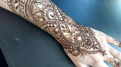 Henna design on lower arm, hand and fingers