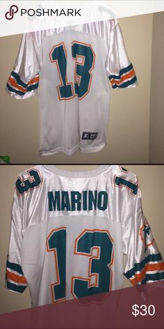 Dolphins Marino sports jersey Never worn large dolphins #13 sports jersey. It would work for a guy or a girl. Good condition and only wore once! Tops